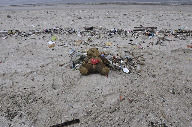 pollution-teddy-bear-beach-trash