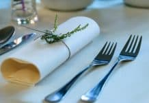 stainless-steel-fork-beside-rolled-paper-towel